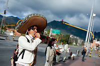 BOGOTA, COLOMBIA - May 24 2020: Mariachis from the Mariachi Juvenil Americas group perform in front of residential buildings amid the COVID-19 Pandemic that changed how they worked on May 24 2020 in Bogotá, Colombia (Photo by Sebastian Barros Salamanca / VIEWpress via Getty Images).