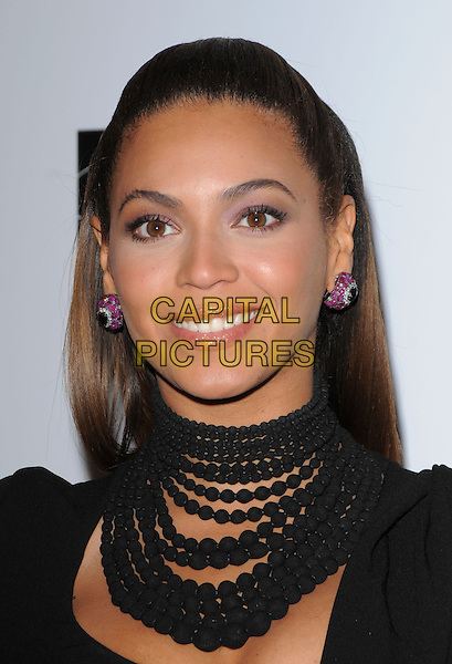 "BEYONCE KNOWLES.The Saks Fifth Avenue's ""Unforgettable Evening"" benefiting EIF's Women's Cancer Research Fund held at The Beverly Wilshire Hotel in Beverly Hills, California, USA..February 10th, 2009                                                                     headshot portrait beads beaded earrings pink diamonds necklaces choker .CAP/DVS.©Debbie VanStory/Capital Pictures."