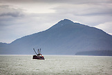 USA, Alaska, Juneau, fishing boat returns to harbor in Stephens Passage