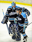29 January 2010: University of Maine Black Bears' goaltender Scott Darling, a Sophomore from Lemont, IL, celebrates a win with teammate Klas Leidermark, a Freshman from Gavle, Sweden, at the end of the third period against the University of Vermont Catamounts at Gutterson Fieldhouse in Burlington, Vermont. The Black Bears defeated the Catamounts 6-3 in the first game of their America East weekend series. Mandatory Credit: Ed Wolfstein Photo