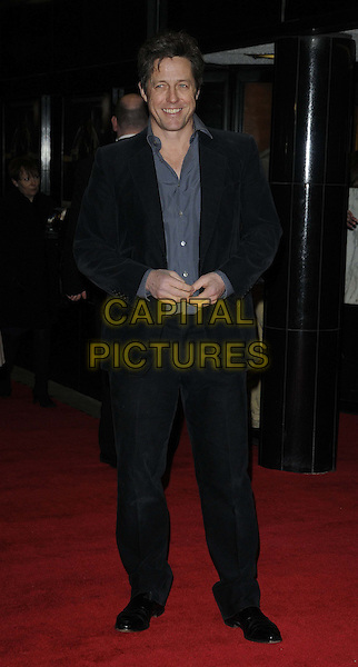 "Hugh Grant.The ""Cloud Atlas"" UK gala screening, Curzon Mayfair cinema, London, England..February 18th, 2013.full length black suit blue grey gray shirt         .CAP/CAN.©Can Nguyen/Capital Pictures."