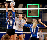 BROOKINGS, SD - SEPTEMBER 1:  Kacey Hermann #3 from South Dakota State looks to get a kill past Kyla Inderski #15 and Katie Dulek #11 from Drake in the Jacks home opener Tuesday night at Frost Arena.  (Photo by Dave Eggen/Inertia)