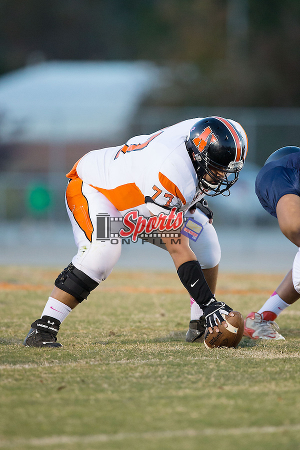 Tristan Westover (77) of the Northwest Cabarrus Trojans prepares to snap the ball during first half action against the Carson Cougars in JV football action at Jesse Carson High School on October 24, 2014, in China Grove, North Carolina.  The Cougars defeated the Trojans 35-6.  (Brian Westerholt/Sports On Film)