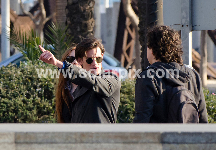 "**ALL ROUND EXCLUSIVE PICTURES FROM SOLARPIX.COM** .**DOUBLE SPACE RATES APPLY**.**MINIMUM PUBLICATION FEE-£150.00 PER PIC**                                                                                                                                             **WORLDWIDE SYNDICATION RIGHTS**                                                                                  Dr Who filming in Spain..Dr Who actor Matt Smith and Karen Gillan who plays his companion Amy Pond are currently in Almeria, Spain, filming an episode called ""Gun Slingers""..Matt & Karen were spotted out and about in the city of Almeria on their day off from filming at the cowboy studios, made famous by the Spaghetti Westerns. They visited a local cafe then took a stroll to Burger King. They were both busy on their mobile phones.                                                                         This pic:    Matt Smith and Karen Gillan                                                                                     JOB REF:   14558   RAP       DATE:  12.03.12                                                          **MUST CREDIT SOLARPIX.COM OR DOUBLE FEE WILL BE CHARGED**                                                                      **MUST AGREE FEE BEFORE ONLINE USAGE**                               **CALL US ON: +34 952 811 768 or LOW RATE FROM UK 0844 617 7637**"