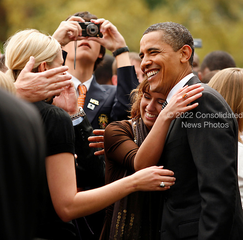 "Washington, DC - April 30, 2009 -- United States President Barack Obama gets a hug from Angelica Guarino, whose fiance was one of the participants in the ""White House to Light House"" Wounded Warrior Soldier Ride that took place moments before on the South Lawn of the White House, Washington, DC, Thursday, April 30, 2009..Credit: Martin H. Simon - Pool via CNP"