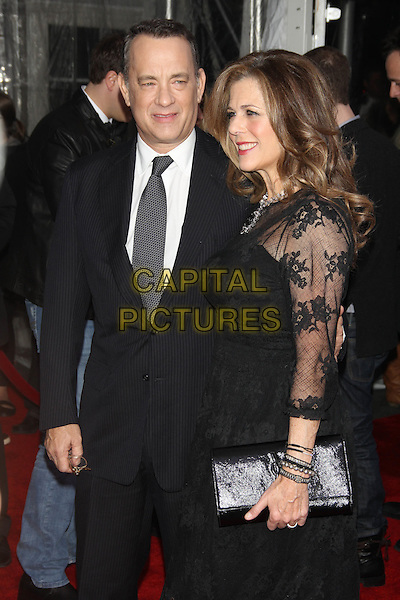 "Tom Hanks and wife Rita Wilson .attending the New York Premiere of ""Extremely Loud & Incredibly Close"" at the Ziegfeld Theater, New York, NY, USA, December 15th, 2011..half length grey gray white shirt suit tie black smiling married couple husband lace dress clutch bag .CAP/LNC/TOM.©LNC/Capital Pictures."