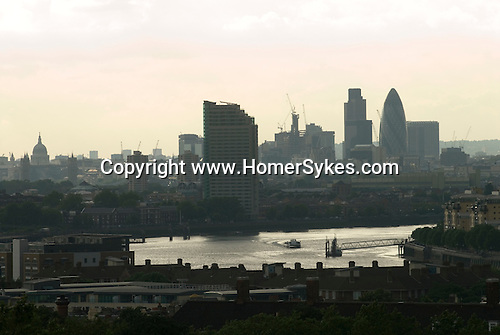 The river Thames looking west up river from Greenwich Park. fr Left to Right:- St Pauls Cathedral behind Tower Bridge, the Gherkin. London 2006