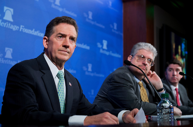 "UNITED STATES - MAY 6: From left, Former Sen. Jim DeMint, R-S.C., president of the Heritage Foundation, Robert Rector, and Derrick Morgan, both of the Heritage Foundation, conduct a news conference at the Foundation's offices to discuss the U.S. Senate's ""Gang of Eight"" immigration bill and how the amnesty portion would have negative effects on the economy. (Photo By Tom Williams/CQ Roll Call)"