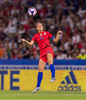 LYON,  - JULY 2: Alex Morgan #13 heads the ball during a game between England and USWNT at Stade de Lyon on July 2, 2019 in Lyon, France.