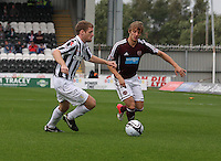 Arvydas Novikovas takes on David van Zanten in the St Mirren v Heart of Midlothian Clydesdale Bank Scottish Premier League match played at St Mirren Park, Paisley on 15.9.12.