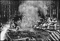 BNPS.co.uk (01202 558833)<br /> Pic:   HistoryPress/BNPS<br /> <br /> Ann Moffat sitting around a smoky campfire with other Lumberjills on the Isle of Wight.<br /> <br /> These inspiring photos tell the little known story of the patriotic women who chopped down trees to help us win the Second World War.<br /> <br /> When war was declared in September 1939 Britain was almost completely dependent on imported timber and only had seven months worth of it stockpiled.<br /> <br /> With men being sent to the front line in their droves, the Woman's Timber Corps was established to fell trees, operate sawmills and run forestry sites.<br /> <br /> About 15,000 women, some as young as 14, volunteered to carry out the arduous tasks previously done by men.