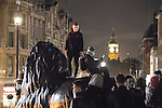 © Joel Goodman - 07973 332324 . 05/11/2016 . London , UK . Supporters of Anonymous , many wearing Guy Fawkes masks , attend the Million Mask March bonfire night demonstration , in Trafalgar Square in central London . Photo credit : Joel Goodman