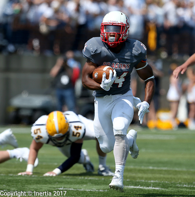 SIOUX FALLS, SD - SEPTEMBER 2: Herman Gray #24 from the University of Minnesota Morehead breaks loose past Collin Holt #54 from Augustana in the first half of their game Saturday afternoon at Augustana University. (Photo by Dave Eggen/Inertia)