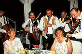 Budapest, Hungary. Traditional Hungarian gypsy band playing for guests at a restaurant; violin, cello, clarinet.