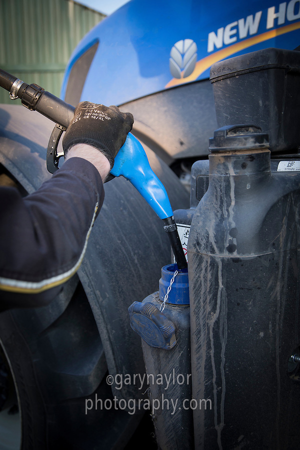 Filling a tractor with AdBlue diesel emmissions additive