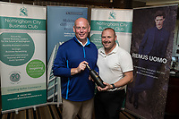 NCBC President Ian Roberts hands over the Longest Drive 4th Hole prize of Vodka  donated by John Pye Property to Paul Macmillan of Gas Container Services