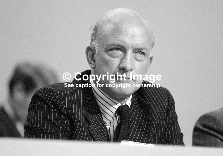Geoffrey Pattie, MP, junior minister, House of Commons, Conservative Party, UK, on platform during his party's 1984 annual conference, Brighton, the year the adjacent Grand Hotel, was bombed by the Provisional IRA. The Grand Hotel was where most cabinet members and senior party officials were staying. 19840139GP2.<br /> <br /> <br /> Copyright Image from Victor Patterson,<br /> 54 Dorchester Park, <br /> Belfast, UK, BT9 6RJ<br /> <br /> t1: +44 28 9066 1296 (from Rep of Ireland 048 9066 1296)<br /> t2: +44 28 9002 2446 (from Rep of Ireland 048 9002 2446)<br /> <br /> m: +44 7802 353836<br /> <br /> e: victorpatterson@me.com<br /> www.victorpatterson.com<br /> <br /> Please see my Terms and Conditions of Use at www.victorpatterson.com. It is IMPORTANT that you familiarise yourself with them.<br /> <br /> Images used on the Internet must be visibly watermarked i.e. &copy; Victor Patterson<br /> within the body of the image and copyright metadata must not be deleted. Images <br /> used on the Internet have a size restriction of 4kbs and will be chargeable at current<br />  NUJ rates unless agreed otherwise.<br /> <br /> This image is only available for the use of the download recipient i.e. television station, newspaper, magazine, book publisher, etc, and must not be passed on to any third <br /> party. It is also downloaded on condition that each and every usage is notified within 7 days to victorpatterson@me.com<br /> <br /> The right of Victor Patterson to be identified as the author is asserted in accordance with The Copyright Designs And Patents Act (1988). All moral rights are asserted.