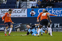 Garry Thompson of Wycombe Wanderers (centre) battles for the ball during the Sky Bet League 2 match between Luton Town and Wycombe Wanderers at Kenilworth Road, Luton, England on 26 December 2015. Photo by David Horn.
