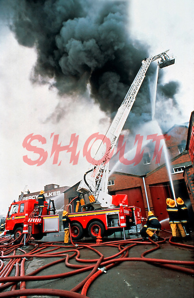 Firefighters attend a large factory fire. They use a Hydraulic Platform to aim the water directly onto the unit Oxfordshire UK. This image may only be used to portray the subject in a positive manner..©shoutpictures.com...john@shoutpictures.com