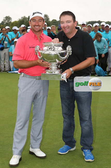 GRAEME MCDOWELL (NIR) celebrate his back to back win at the Alstom Open de France with caddie Ken Comboy, from Le Golf National, Guyancourt, Versailles, France. Picture:  David Lloyd / www.golffile.ie