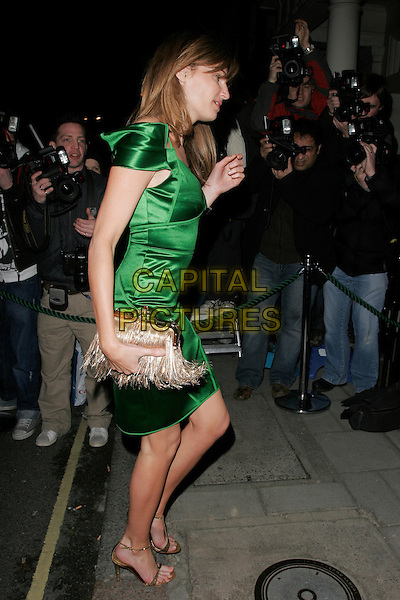 JEMIMA KHAN.Finch and Partners Pre-Bafta Party held at Mark's Club, Mayfair, London, England. .February 9th 2008.full length green dress gold tassle tassel purse profile .CAP/AH.©Adam Houghton/Capital Pictures.