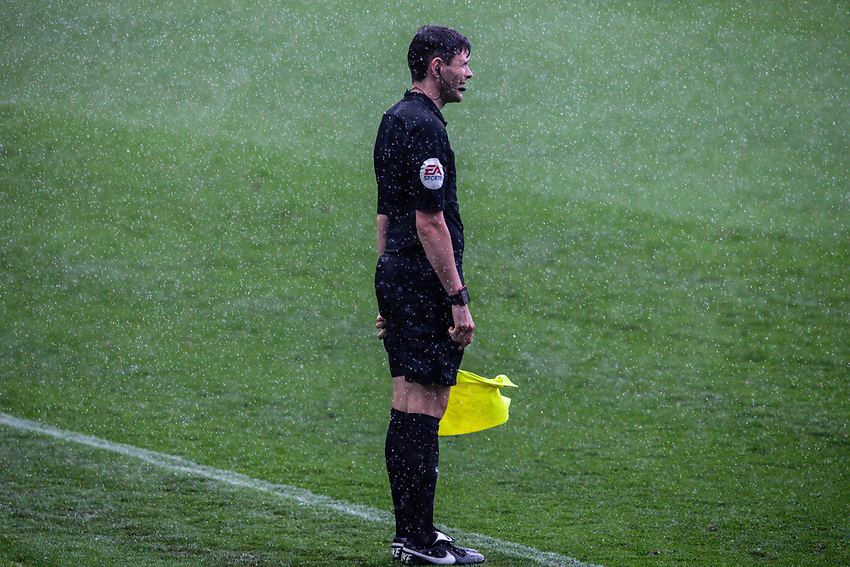 The assistant referee braves a torrential downpour<br /> <br /> Photographer Alex Dodd/CameraSport<br /> <br /> The EFL Sky Bet Championship - Leeds United v Fulham - Wednesday 24th June 2020 - Elland Road - Leeds<br /> <br /> World Copyright © 2020 CameraSport. All rights reserved. 43 Linden Ave. Countesthorpe. Leicester. England. LE8 5PG - Tel: +44 (0) 116 277 4147 - admin@camerasport.com - www.camerasport.com<br /> <br /> Photographer Alex Dodd/CameraSport<br /> <br /> The Premier League - Newcastle United v Aston Villa - Wednesday 24th June 2020 - St James' Park - Newcastle <br /> <br /> World Copyright © 2020 CameraSport. All rights reserved. 43 Linden Ave. Countesthorpe. Leicester. England. LE8 5PG - Tel: +44 (0) 116 277 4147 - admin@camerasport.com - www.camerasport.com