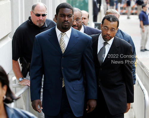 Atlanta Falcons football player Michael Vick arrives  with his attorney Billy Martin, right, at federal court in Richmond, Va., Monday, Aug. 27, 2007. Vick is to plead guilty on dog fighting charges. (AP Photo/Steve Helber/POOL)