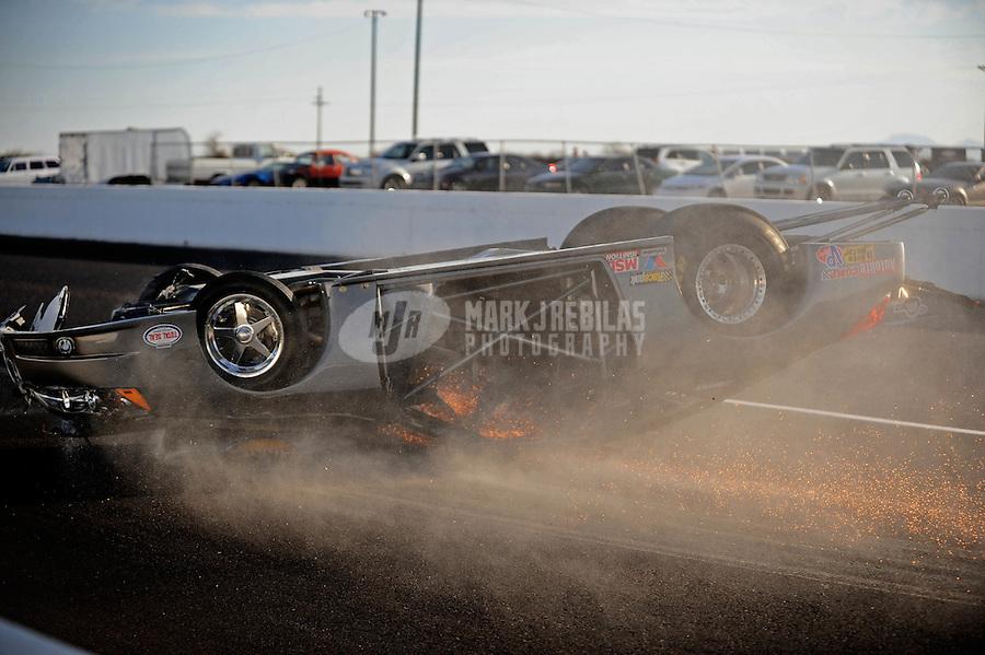 Feb. 19, 2010; Chandler, AZ, USA; NHRA pro stock driver Gordie Rivera crashes during qualifying for the Arizona Nationals at Firebird International Raceway. Mandatory Credit: Mark J. Rebilas-