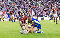Picture by Allan McKenzie/SWpix.com - 13/07/2017 - Rugby League - Betfred Super League - Wigan Warriors v Warrington Wolves - DW Stadium, Wigan, England - Warrington's Ben Currie touches down for a try as Wigan's Sam Tomkins can only look on.