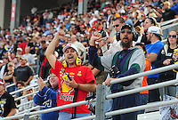 Nov. 8, 2009; Fort Worth, TX, USA; NASCAR Sprint Cup Series fans cheer after Jimmie Johnson crashed on the second lap during the Dickies 500 at the Texas Motor Speedway. Mandatory Credit: Mark J. Rebilas-