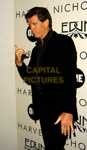 "PIERCE BROSNAN.""Edun One"" launch party, Harvey Nichols, London, UK..October 18th, 2006.Ref: CAN.half length black suit jacket hand gesture.www.capitalpictures.com.sales@capitalpictures.com.©Can Nguyen/Capital Pictures"