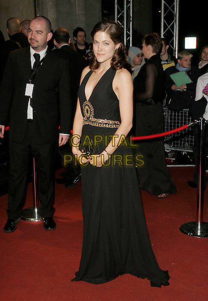 CHARITY WAKEFIELD.The British Academy Television Awards 2008 after party held at the Grosvenor House Hotel, London, England. .April 20th 2008.BAFTA BAFTA's full length long black dress gown gold beaded clutch bag purse .CAP/AH.©Adam Houghton/Capital Pictures.