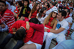 Two persons sleep before the second bull run of the San FermÍn Festival in Pamplona, northern Spain, on July 8, 2013. © Pedro ARMESTRE