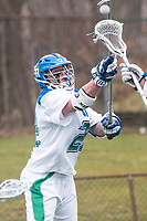 Danny Kelly,'17, fights for posession as the Seahawks battle Roger Williams in Men's Lacrosse game action at Gaudet Field in Middletown.