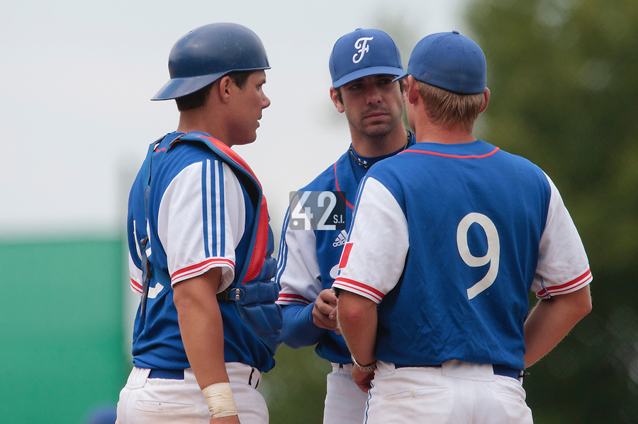 30 july 2010: Pierrick Le Mestre of France talks to pitching coach Jeff Zeilstra, next to Boris Marche (left) pitches against Italy during Italy 9-2 win over France, in day 6 of the 2010 European Championship Seniors, at TV Cannstatt ballpark, in Stuttgart, Germany.