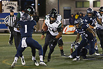 Hawaii running back Hekili Keliiliki (44) runs thru the Nevada line in the second half of an NCAA college football game in Reno, Nev. Saturday, Sept. 28, 2019. (AP Photo/Tom R. Smedes)