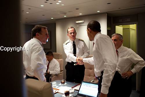 President Barack Obama shakes hands with Admiral Michael Mullen, chairman of the Joint Chiefs of Staff, aboard Air Force One en route to Washington, D.C., after delivering his Afghanistan speech at the U.S. Military Academy at West Point, Dec, 1, 2009. (Official White House Photo by Pete Souza) <br /> <br /> This official White House photograph is being made available only for publication by news organizations and/or for personal use printing by the subject(s) of the photograph. The photograph may not be manipulated in any way and may not be used in commercial or political materials, advertisements, emails, products, promotions that in any way suggests approval or endorsement of the President, the First Family, or the White House.