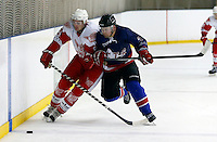Romanas Fedotovas (L) in action for Haringey during the National Ice Hockey League South Division 2 Cup - Group B game between Haringey Racers and Slough Jets at Alexandra Palace, London on Sat Sept 13, 2014.