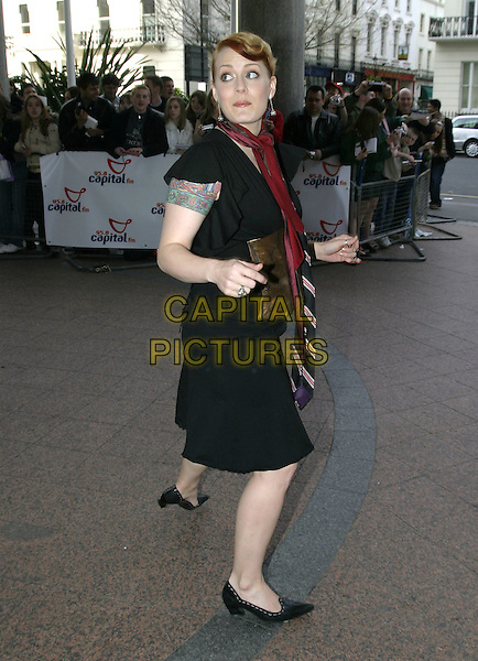 ANA MATRONIC (SCISSOR SISTERS).Capital FM Awards 2005, held in aid of Help a London Child, Royal Lancaster hotel, London, March 23rd 2005..full length anna mantronic tattoo on arm black dress.Ref: AH.www.capitalpictures.com.sales@capitalpictures.com.©Adam Houghton/Capital Pictures.