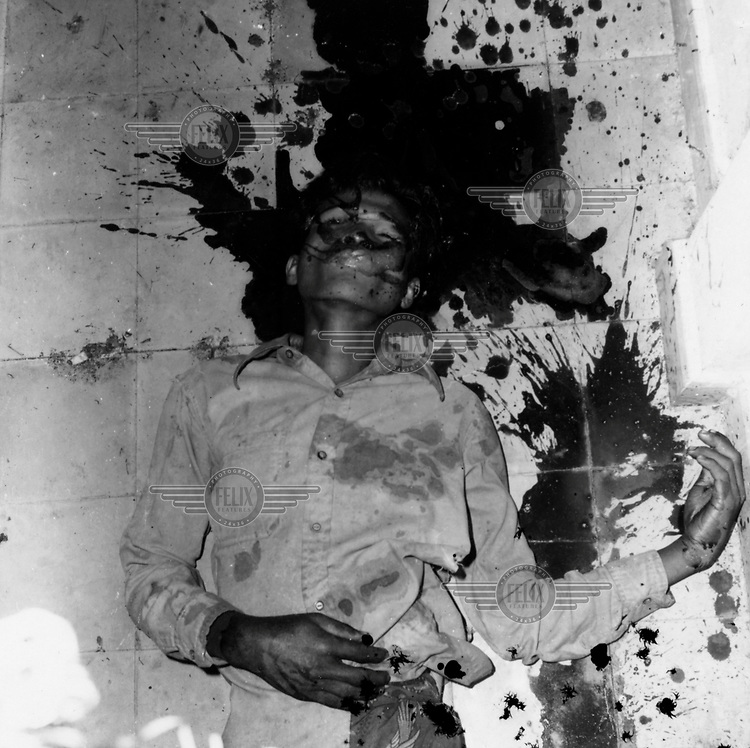 A prisoner executed by the Khmer Rouge at their S-21 detention centre at Tuol Sleng, where over 16,000 inmates were killed between 1975 and 1979. The photograph was taken by the Khmer.