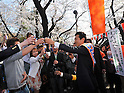 April 7, 2011, Tokyo, Japan - Miki Watanabe, a candidate running for governor of Tokyo, joins revelers in a feast under full-blown cherry blossoms at Tokyo's Ueno Park during his street campaign on Thursday, April 7, 2011. Watanabe, the founder of a chain of casual pubs, is running in the April 10 Tokyo gubernatorial election, attempting to make the big jump from business manager to big-time politician. (Photo by AFLO) [3609] -mis-