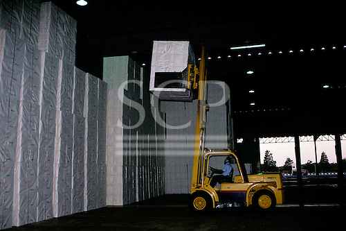 Vitoria, Brazil. Forklift truck stacking paper in the warehouse of the Aracruz paper factory.