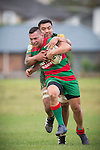 Jamie Baker gets tackled from behind by George Crichton as he makes a run upfield for Waiuku. Counties Manukau Premier Club Rugby game between Pukekohe and Waiuku, played at Colin Lawrie Field, Pukekohe, on Saturday May 03 2014. Pukekohe won the game 28 - 10 afterleading 21 - 10 at halftime  Photo by Richard Spranger