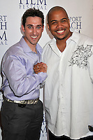 "PAUL J. ALESSI, producer/actor & OMAR GOODING.""Knuckle Draggers"" Premiere at the 2009 Newport Beach Film Festival held at Edwards Cinemas, Newport Beach, CA, USA..April 27th, 2009.half length red dress white shirt purple shaking holding hands .CAP/ADM/BP.©Byron Purvis/AdMedia/Capital Pictures."