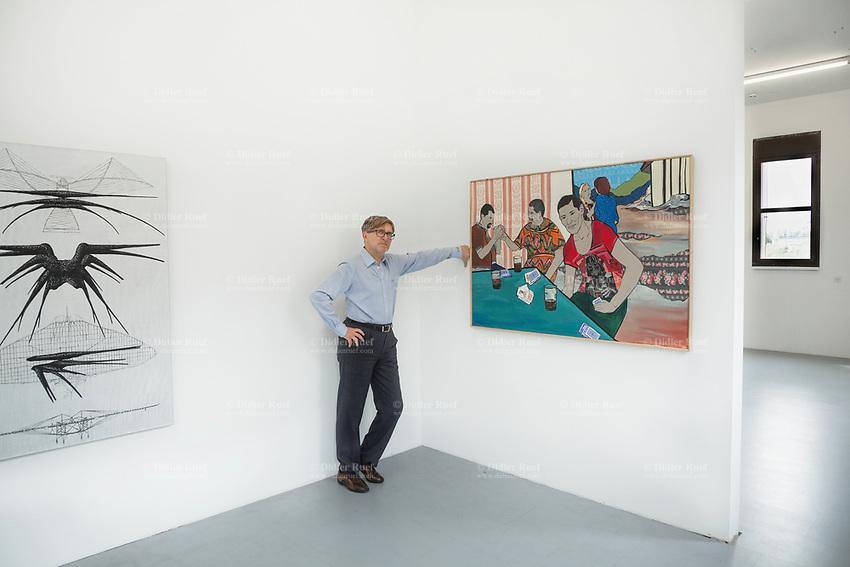 "Switzerland. Canton Ticino. Locarno. Riccardo Lisi is the director of the art gallery "" la rada"" ( Spazio per l'arte contemporanea).  ""Shadow Ship"" (2019) (L) is a painting by swiss artist Mathis Gasser. ""Chaco he dad ""(Son and Father)(2016)(R) is a painting by artist Malgorzata Mirga-Tas. Małgorzata Mirga-Tas is a Bergitka Roma visual artist living in Poland. 1.05.2020 © 2020 Didier Ruef"