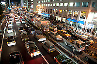 Gridlocked traffic and crowded pavements, Shinagawa, Tokyo, 11 March 2011. After a huge earthquake in north-east Japan several million people in Tokyo struggle to return home.