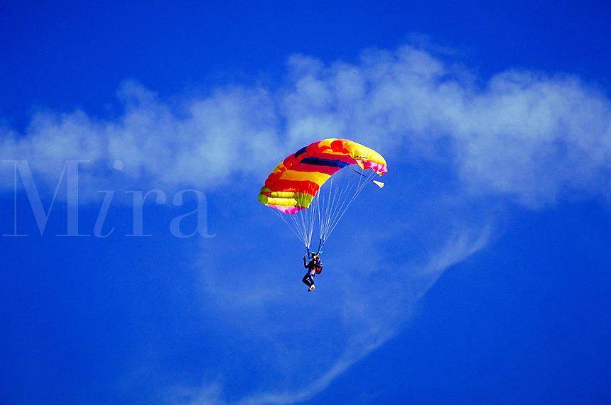 SKYDIVER DESCENDING WITH PARACHUTE OPEN. GIBERTSVILLE PENNSYLVANIA. USA.