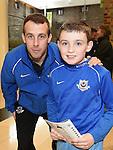 Matthew Brogan Mallon with Drogheda United player Cathal Brady at Scotch Hall. Photo:Colin Bell/pressphotos.ie