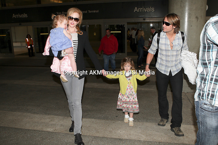 [NO Australia, NO New Zealand] Los Angeles, CA - Actress Nicole Kidman and family in a good mood after a long flight from Sydney, Australia....AKM-GSI          June 22, 2012...To License These Photos, Please Contact :..Steve Ginsburg.(310) 505-8447.(323) 4239397.steve@ginsburgspalyinc.com.sales@ginsburgspalyinc.com..or..Keith Stockwell.(310) 261-8649.(323) 325-8055 .keith@ginsburgspalyinc.com.ginsburgspalyinc@gmail.com