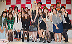 September 25, 2012, Tokyo, Japan - American actress, musician and model, Taylor Momsen, and invited Samantha Thavasa customers pose for a photo on stage during a promotional event for the fashion brand Samantha Thavasa. (Photo by Christopher Jue/AFLO)